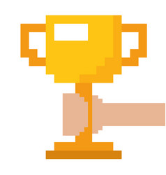 Pixelated hand holding trophy cup game vector