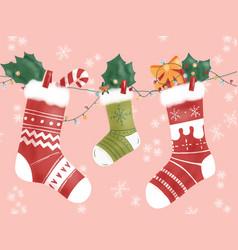 Three winter socks hanging on christmas decoration vector