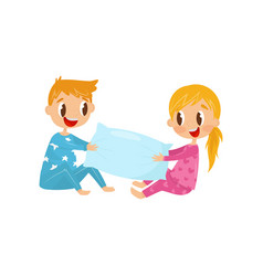 Cute kids in pajamas playing with pillow brother vector