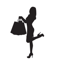 black silhouette woman holding shopping bags vector image