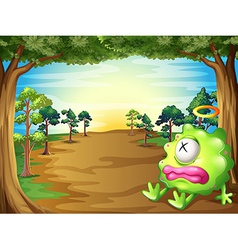 A green monster at the forest resting under the vector image