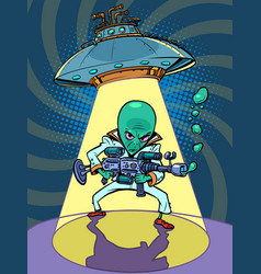 Ufo flying saucer with an evil green man alien vector