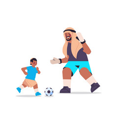 Young arab father playing football with son vector