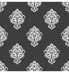 Geometric seamless pattern with floral motifs vector image vector image