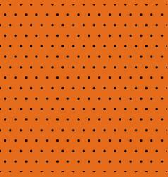 Black polka dots on orange background vector