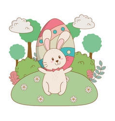 little rabbit with egg painted in the garden vector image