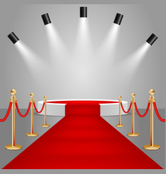 Spotlights and stage podium with red carpet vector