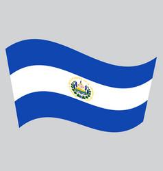 flag of el salvador waving on gray background vector image