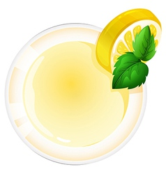 A topview of a glass with a lemon juice vector image