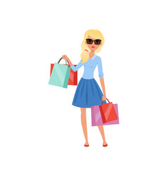 Young blond girl holding lots of colorful shopping vector