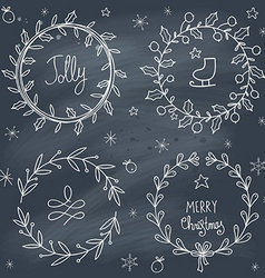 Christmas wreaths set on blackboard vector image