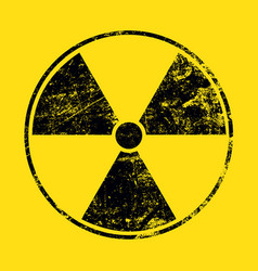Black radioactive sign over yellow background vector