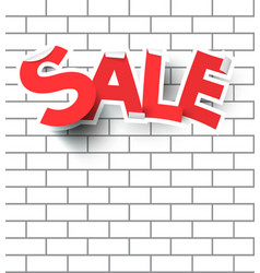 Sale text on white brick wall vector