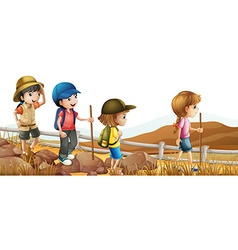 Children hiking up the mountain vector image