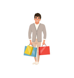 smiling guy standing with shopping bags in hands vector image