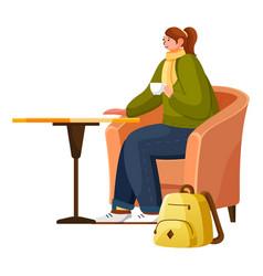 woman drinking hot beverage in restaurant vector image