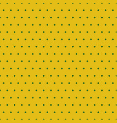 Green polka dots on yellow background vector