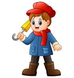 Cartoon boy in blue coat wi vector