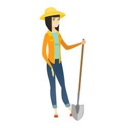 young asian farmer holding a shovel vector image
