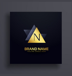premiun letter n logo concept design in gold vector image