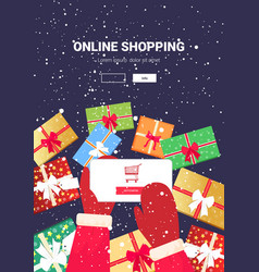 santa hands using mobile app online shopping vector image
