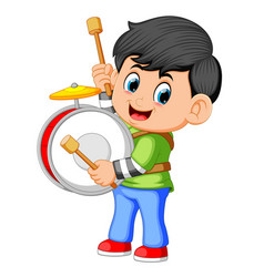 a boy playing big drums vector image