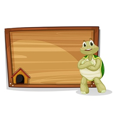 A turtle beside a wooden board vector image