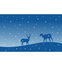 Silhouette of deer with snowfall Christmas scenery vector image vector image