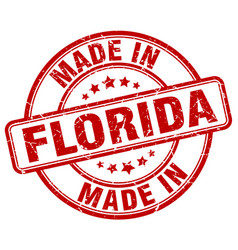 Made in florida red grunge round stamp vector