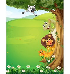 A tree at the top of the hills with animals hiding vector image