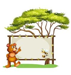 A notice board a bear and a honey bee vector image vector image