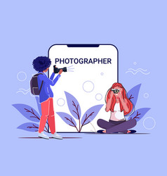 Professional female photographers taking picture vector