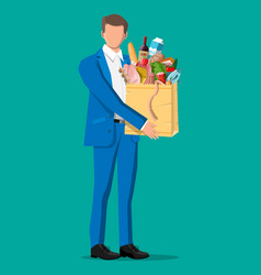 man with shopping bag full fresh products vector image