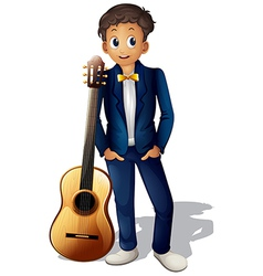 A boy standing beside the guitar vector image vector image