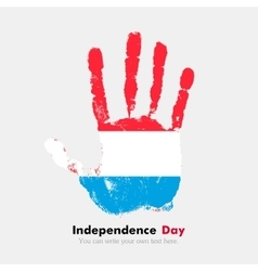 Handprint with the Flag of Luxembourg in grunge vector