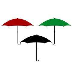 three umbrellas in different colors vector image vector image