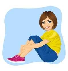 Young woman sitting on the floor vector