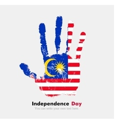 Handprint with the Flag of Malaysia in grunge vector
