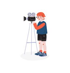 Teen boy recording video with retro camcorder vector