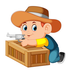 smart cowboy holding his gun and behind the box vector image