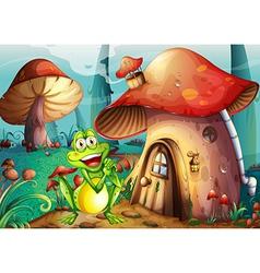 A frog near the mushroom house vector image