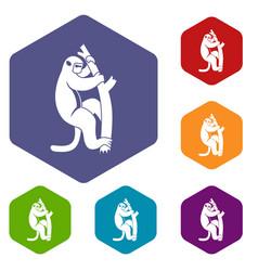 Macaque on a tree icons set hexagon vector