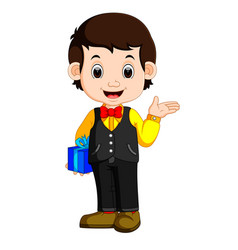 Happy and well dressed boy holding a gift box vector