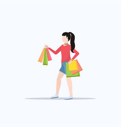 woman holding colorful paper bags young girl vector image