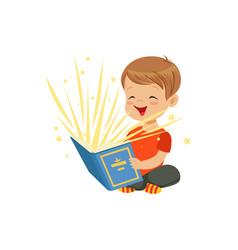Little boy sitting on floor with magic book vector