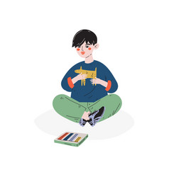 boy making figures from plasticine hobby vector image