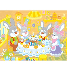 Easter bunnies at the festive table vector image