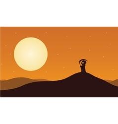 Silhouette of halloween warlock in hills vector image vector image