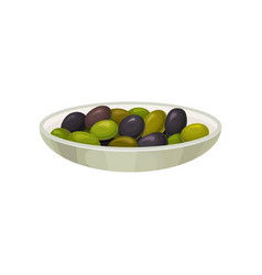 Glass bowl of pickled black and green olives vector