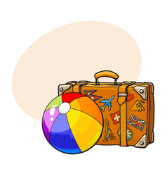 Travel suitcase with colorful labels and rainbow vector